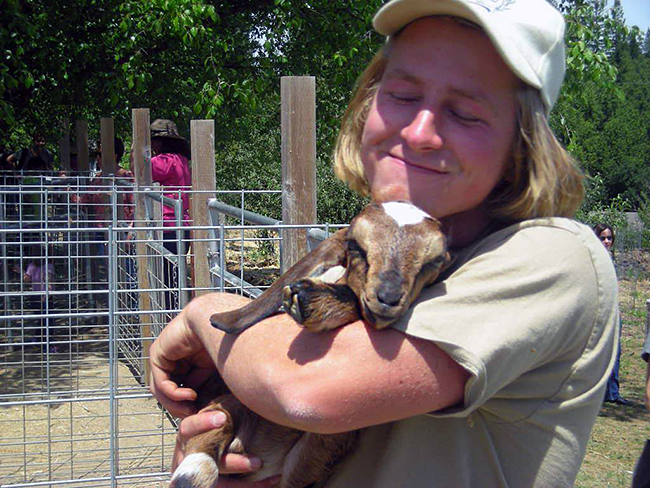 Redwood Hill Farm caregiver with a favorite baby kid